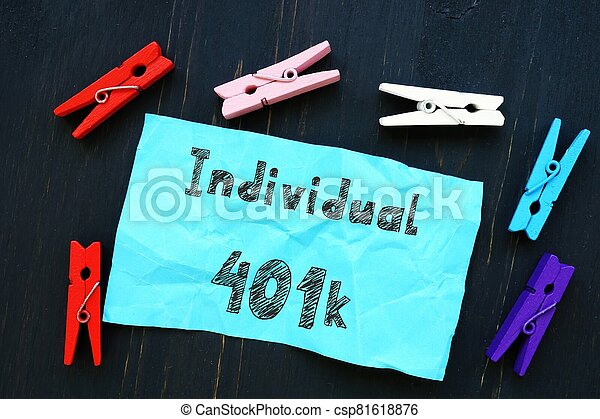The image contains the inscription Individual 401k on a notepad sheet. - csp81618876