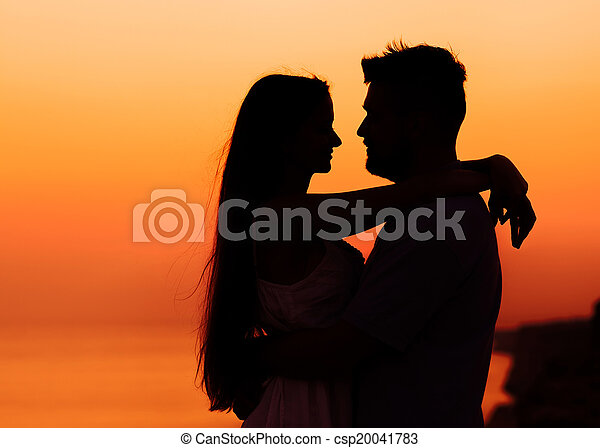 The image of two people in love at sunset - csp20041783