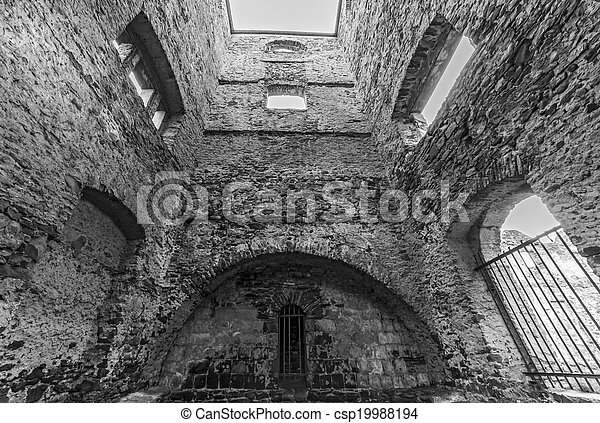 the inside of empty ruined stone tower - csp19988194