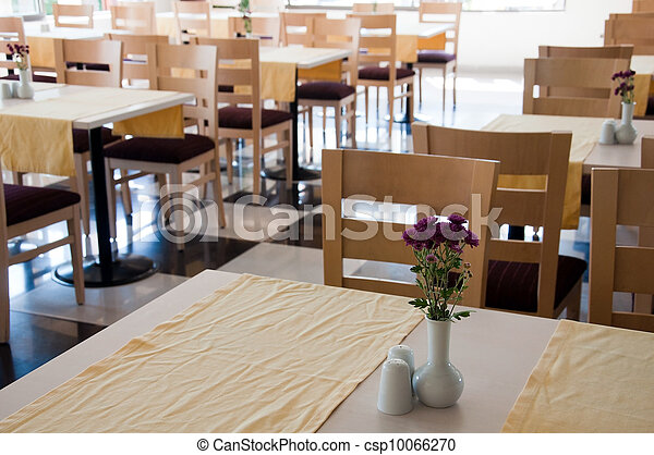 The interior of a cafe with wooden tables - csp10066270