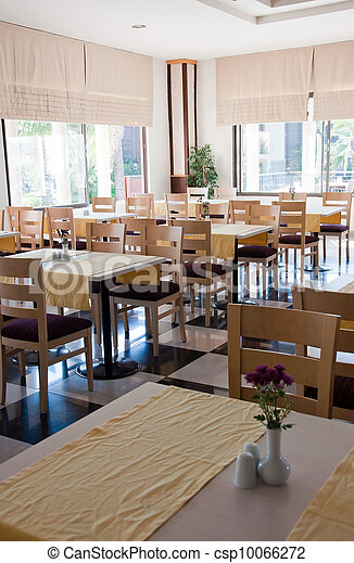 The interior of a cafe with wooden tables - csp10066272