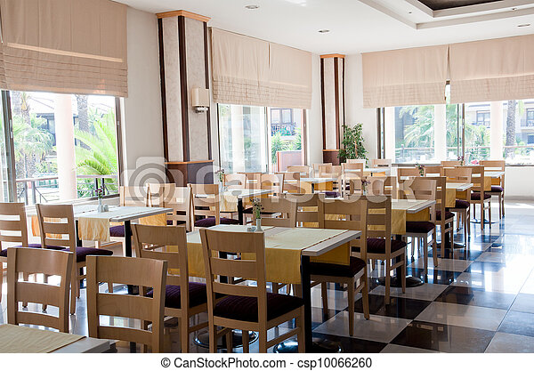 The interior of a cafe with wooden tables - csp10066260