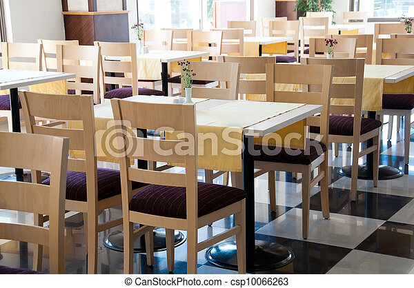 The interior of a cafe with wooden tables - csp10066263