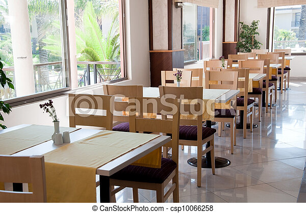 The interior of a cafe with wooden tables - csp10066258