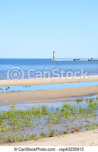 The lighthouse on the shore of Lake Ladoga. - csp43235913