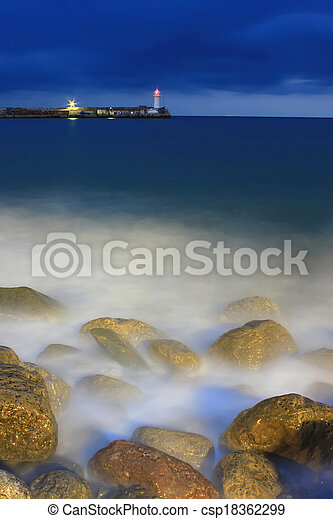 The lighthouse on the shore of the sea storm - csp18362299