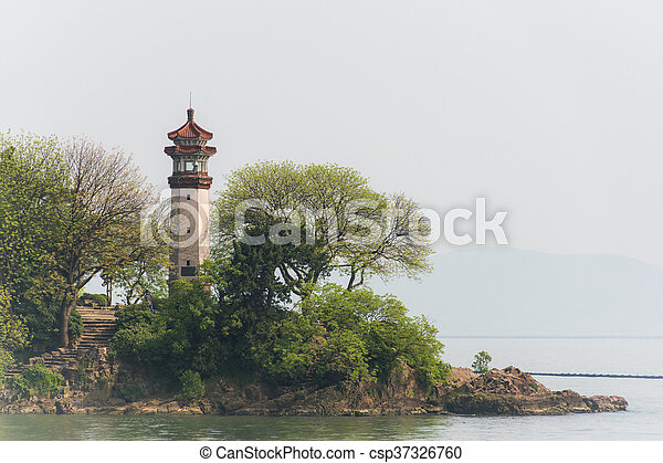 The lighthouse on the shore - csp37326760