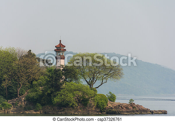 The lighthouse on the shore - csp37326761