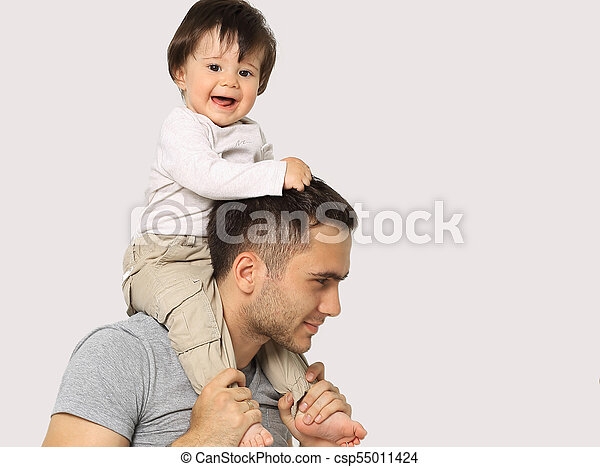 The Little Boy Is Sitting On The Shoulders Of Dad Smiling Kid Boy