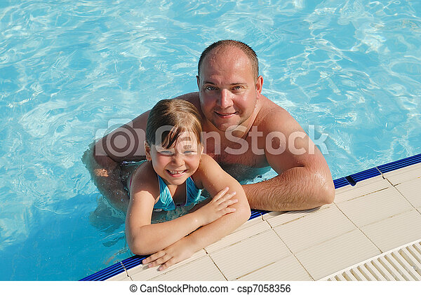 The little girl with the father bathe in pool - csp7058356