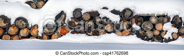 The logs woodpile in the snow in winter. Rural winter scene. HDR - high dynamic range. - csp41762698