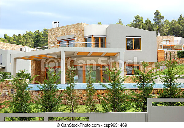 The luxury villa and green lawn, Halkidiki, Greece - csp9631469