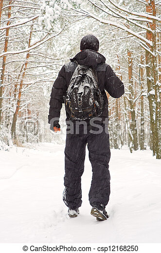 The man walking in winter forest - csp12168250