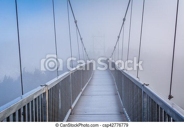 The Mile High Swinging Bridge in fog, at Grandfather Mountain, North Carolina. - csp42776779