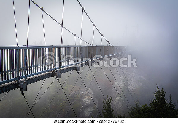 The Mile High Swinging Bridge in fog, at Grandfather Mountain, North Carolina. - csp42776782