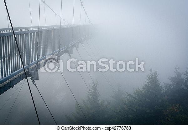 The Mile High Swinging Bridge in fog, at Grandfather Mountain, North Carolina. - csp42776783