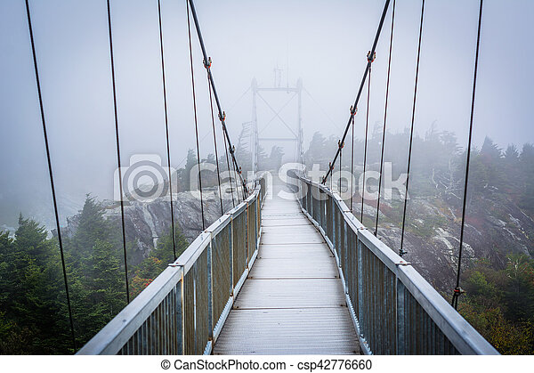 The Mile High Swinging Bridge in fog, at Grandfather Mountain, North Carolina. - csp42776660