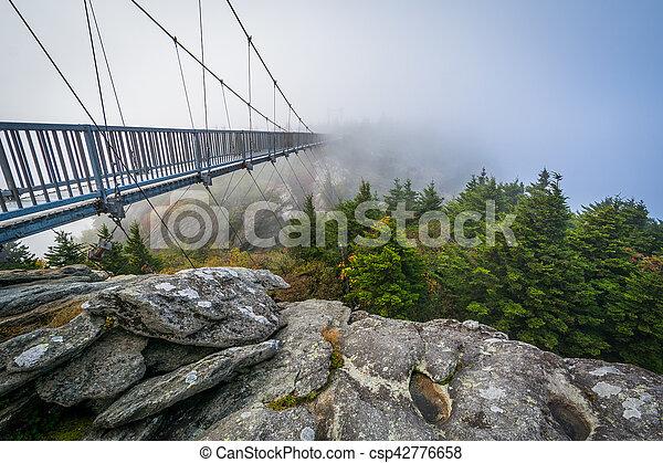 The Mile High Swinging Bridge in fog, at Grandfather Mountain, North Carolina. - csp42776658