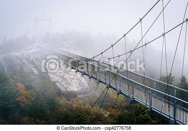 The Mile High Swinging Bridge in fog, at Grandfather Mountain, North Carolina. - csp42776758