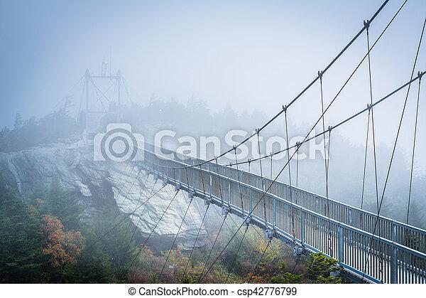 The Mile High Swinging Bridge in fog, at Grandfather Mountain, North Carolina. - csp42776799
