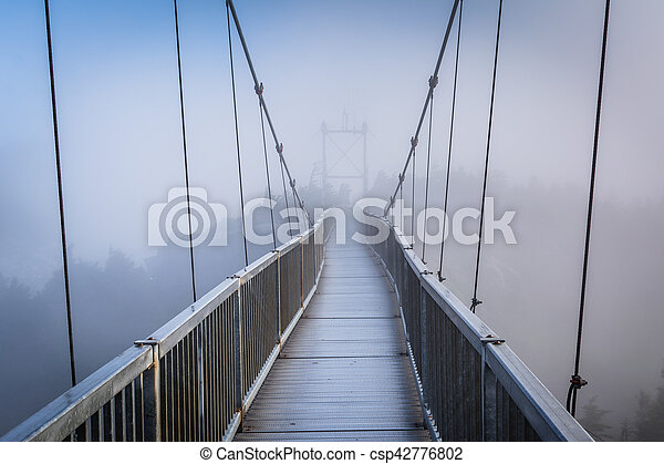 The Mile High Swinging Bridge in fog, at Grandfather Mountain, North Carolina. - csp42776802