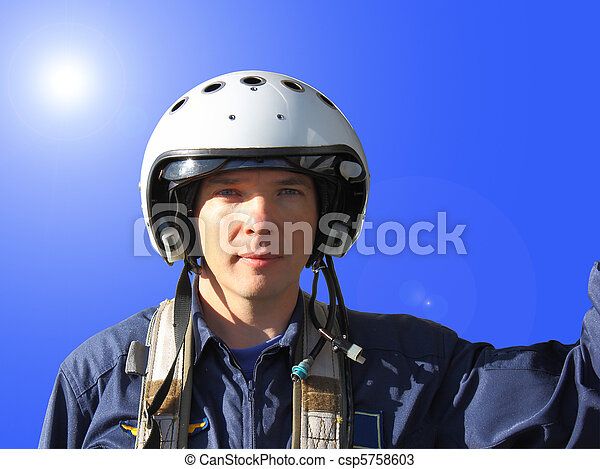 The military pilot in a helmet in dark blue overalls separately  - csp5758603