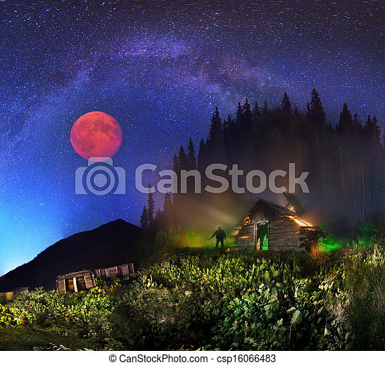 The Milky Way and the moon over the mountains - csp16066483