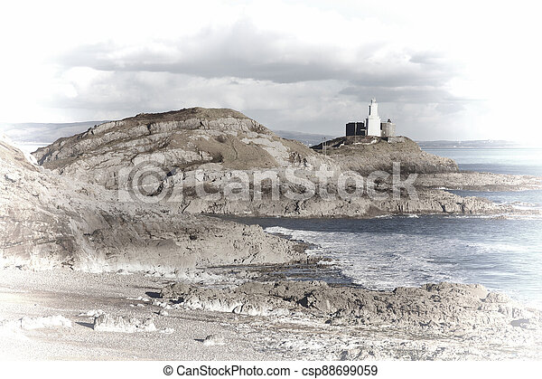 The Mumbles with it's lighthouse as seen from Bracelet Bay on the Gower Peninsular West Glamorgan,Wales UK - csp88699059
