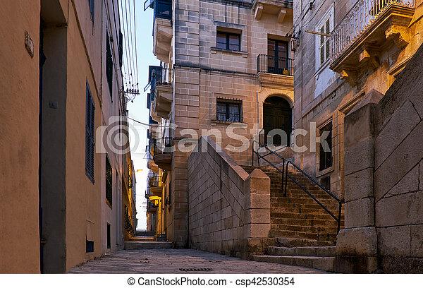 The narrow street Is - Sirena on Senglea in the early morning. Malta - csp42530354