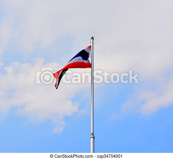 The National Flag of Thailand on blue sky background - csp34704001