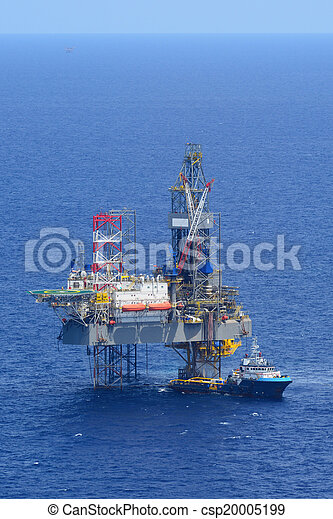 The offshore drilling oil rig and supply boat side view - csp20005199