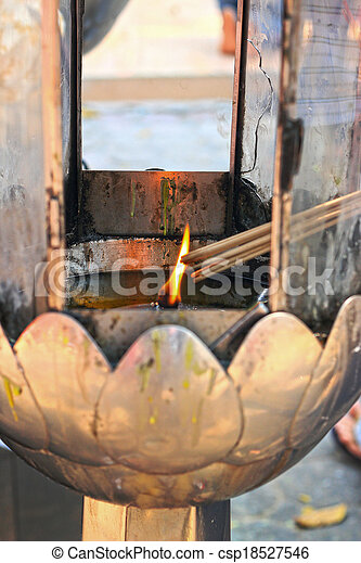 The oil lamps in the temple. - csp18527546