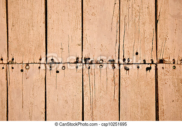 The Old board texture rough and rusted nail background - csp10251695