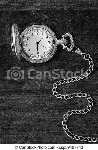 The old clock on a wooden surface - csp59487743
