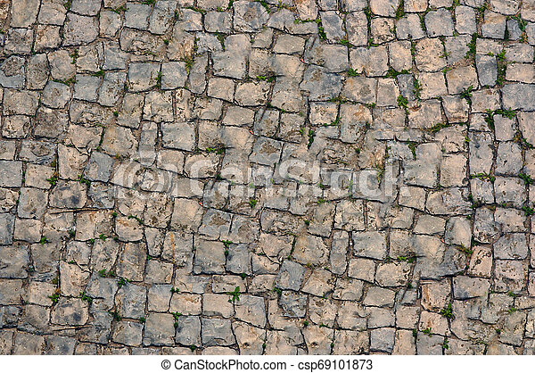 The old curved road with sprouted grass .Texture or background. - csp69101873