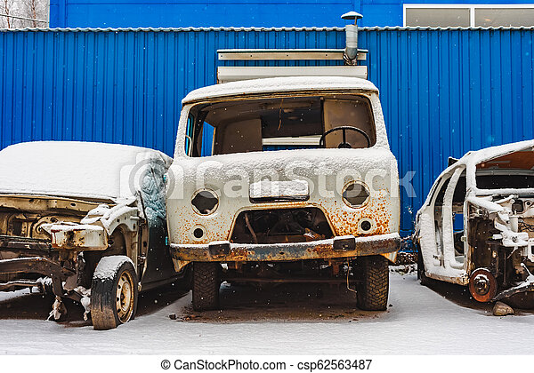 the old rusty broken cars on a dump