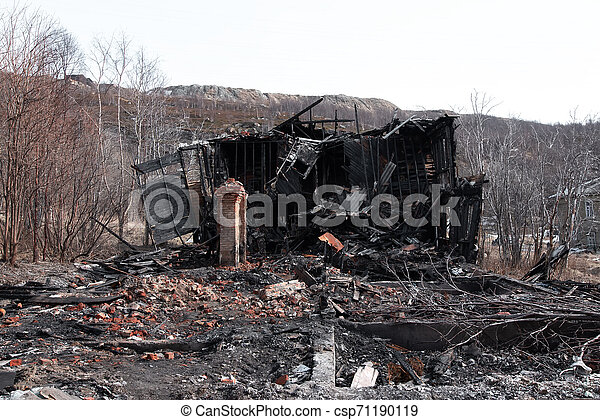 The old wooden burned-down house a view from inside - csp71190119