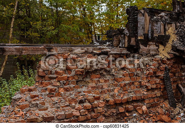 the old wooden burned-down house a view of brick wall from inside - csp60831425