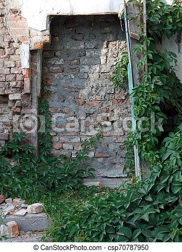 The photo of a brick door - csp70787950