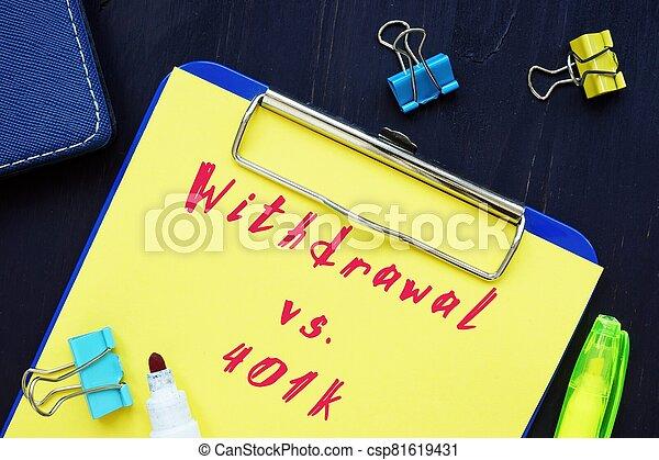The photo shows Hardship Withdrawal vs. 401k. Notepad, heap, marker. - csp81619431