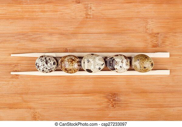 The picture quail eggs - csp27233097
