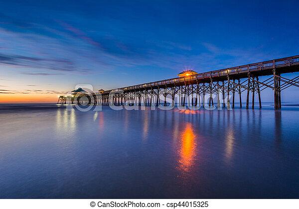 The pier at dawn, in Folly Beach, South Carolina. - csp44015325