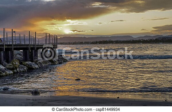 The pier at Salou beach, in Spain, during sunset - csp81449934