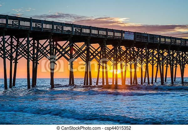 The pier at sunrise, in Folly Beach, South Carolina. - csp44015352
