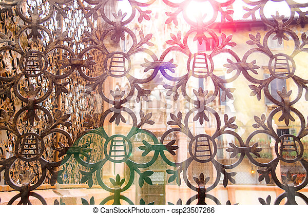 The rays of sun through forged lattice fence Scaliger Tombs in - csp23507266