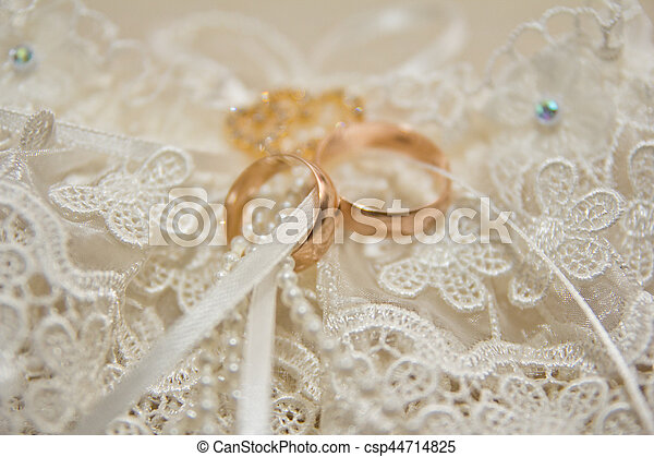 The rings on the flowers, in a box, on a white fabric on toys, colors, wedding details, wedding rings - csp44714825