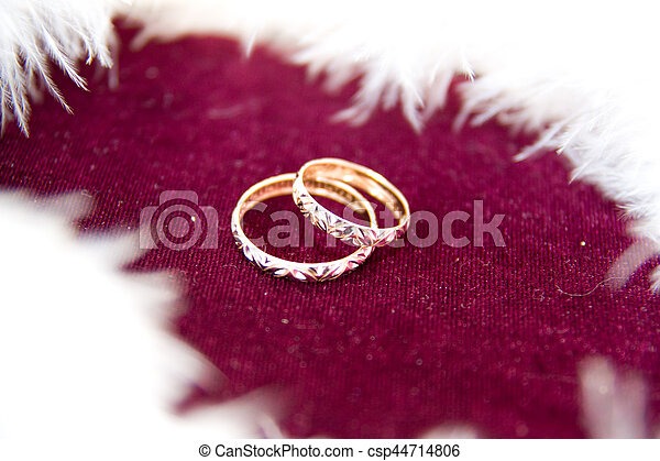 The rings on the flowers, in a box, on a white fabric on toys, colors, wedding details, wedding rings - csp44714806