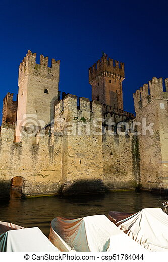 The Scaliger Castle at night in Sirmione, Italy - csp51764044