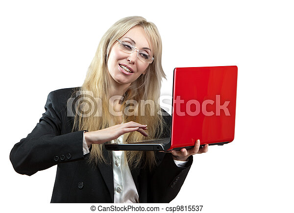The smiling business woman with the red laptop - csp9815537