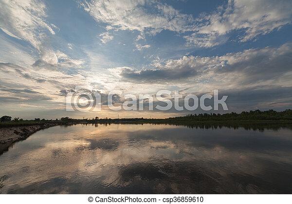 The Springtime Shoreline of a Foggy Mountain Lake at Sunrise - csp36859610